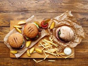 Fast food take away top view. Hamburger, hotdog and fries