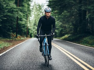 Person on a bike outdoors doing a HIIT cycling workout