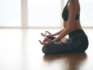 Woman doing mudra during yoga flow