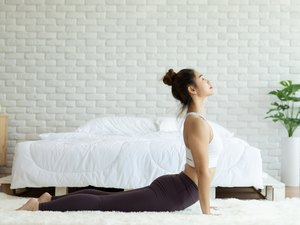 Attractive Asian woman practice yoga Cobra pose to meditation in bedroom after wake up in the morning Feeling so comfortable and relax,Healthcare Concept