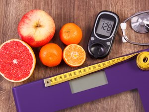 Electronic bathroom scale and glucometer, stethoscope and healthy food