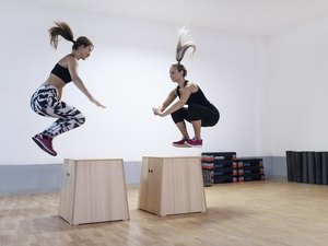 Young Women Athletes Doing Box Jump in the Gym