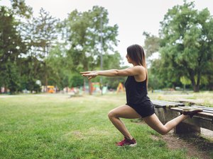 Woman exercising in a public park
