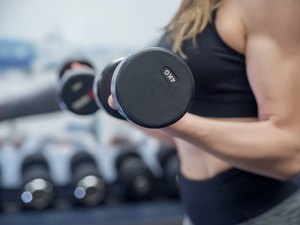 Gym woman Exercising with barbells