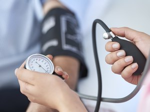 Close view of a nurse taking a patient's blood pressure