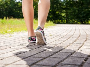 Low Section Of Woman On Footpath In Park