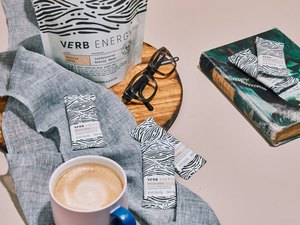 verb energy bars on table with coffee, book and glasses