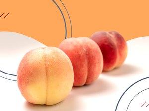Three peaches on an orange and white background