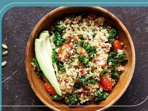 overhead photo of healthy grain bowl with quinoa, tomatoes, parsley and avocado