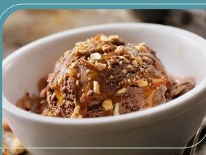 A healthier ice cream sundae with chocolate ice cream and chopped pecans