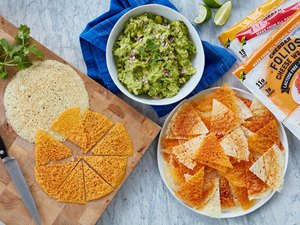 Folios Cheese Wraps on table as crispy crackers with guacamole