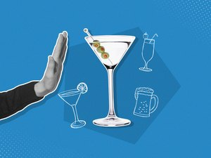 Hand rejecting martini with olives mixed media image