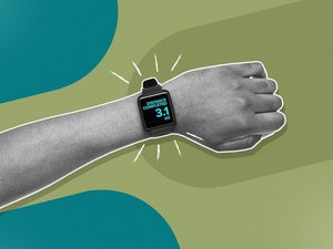 mixed media image showing wrist with fitness tracker showing 5K or 3.1 miles completed