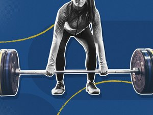 black and white photo of woman grabbing barbell with weight plates on blue background