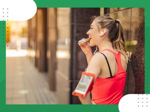 rear view of runner wearing red tank top eating a snack with healthy carbs for fuel