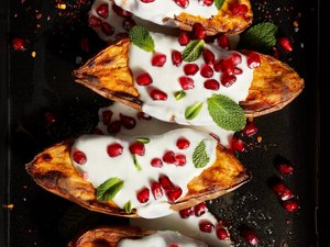 roasted sweet potatoes with yogurt sauce and pomegranates