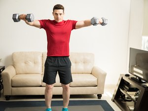 Man working on those shoulders at home