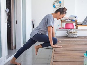 Woman doing elevated mountain climber exercise at home