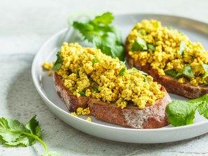 Tofu scramble sandwich on a gray plate. Vegan food concept.