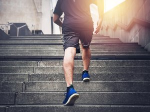 Man walking up stairs during workout