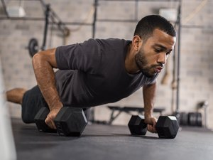 Man Doing Push-Ups With Dumbbells