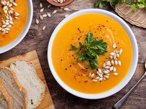 Homemade Pumpkin Soup topped with pumpkin seeds