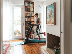 woman running on treadmill at home