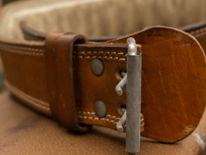 close up of leather weight-lifting belt