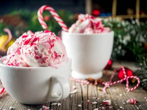 Peppermint Candy Cane Ice Cream in white cup on table with garland