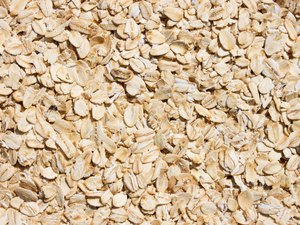 Rolled oats background. Closeup.