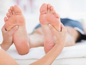 Man having feet massage