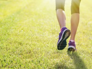 Woman running outdoors in morning