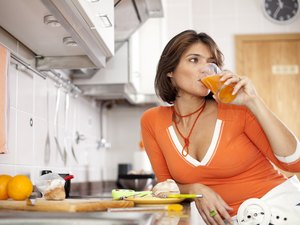 Woman drinking her orange juice