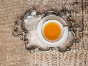 Closeup of cup of tea on vintage textile background
