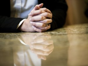 Close-up of human hands on conference table in an office