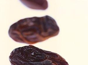 close-up of three dried prunes