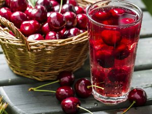Fresh juice made of sweet cherries and ice
