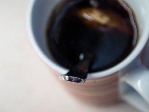 Metal Spoon in Cup of Brewed Tea