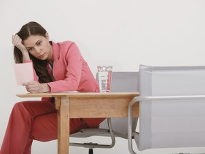 Businesswoman looking at pink slip