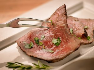Roast beef and serving fork