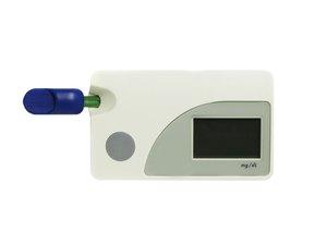 Blood glucose testing kit on white background