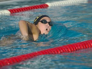 Female Competitive Swimmer Doing Laps