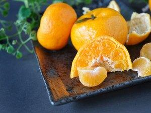 Close up Fresh Orange on Black Plate