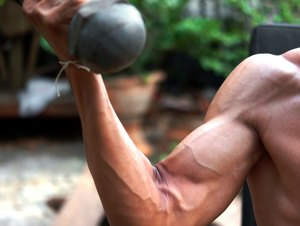 Detail of a Thai man making exercise