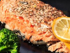 Salmon with broccoli and lemon.