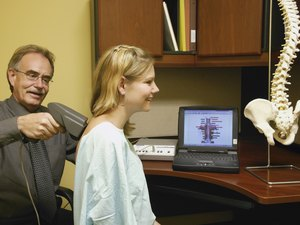 Doctor examining patients back