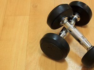 Dumbbells on the wood background.