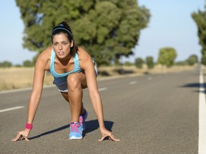 Athletic woman ready for sprint running