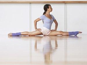 Ballerina On Floor In Split Position