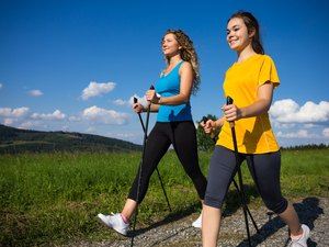 Healthy lifestyle - young women Nordic walking